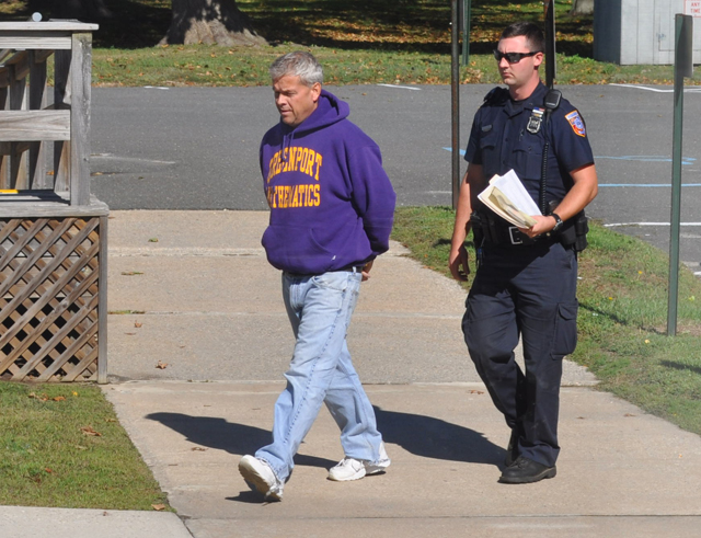 Gordon Haas is led into Southold Town Justice Court following his October arrest. (Credit: Grant Parpan)
