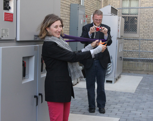JENNIFER GUSTAVSON PHOTO | Greenport school board president Heather Wolf cuts the 'Porter Purple' ribbon Friday unveiling the district's new solar-powered system.