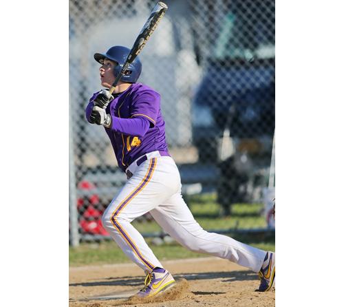 Greenport's Matt Drinkwater following the path of a ball he hit. (Credit: Garret Meade)