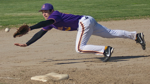 GARRET MEADE PHOTO | Greenport third baseman Matt Drinkwater diving in vain for a ball that was hit into left field.