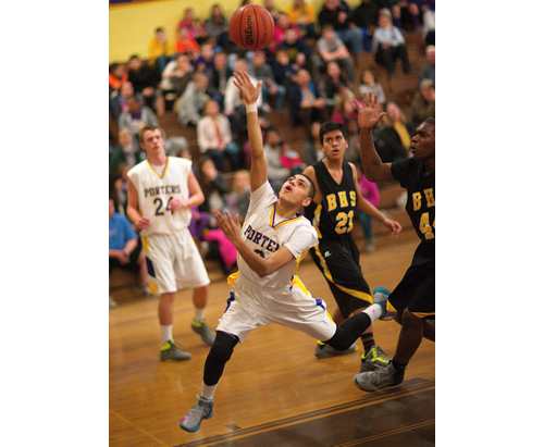 GARRET MEADE PHOTO | An off-balance Angel Colon putting up a shot for Greenport during its county semifinal victory over Bridgehampton on Wednesday night.