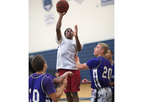 Darius Strickland of Greenport rising up for a shot in a wild game against Hampton Bays. (Credit: Garret Meade)