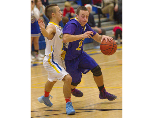 GARRET MEADE PHOTO | Mattituck's Joe Tardif, left, kept in close contact while guarding Greenport's Gavin Dibble.