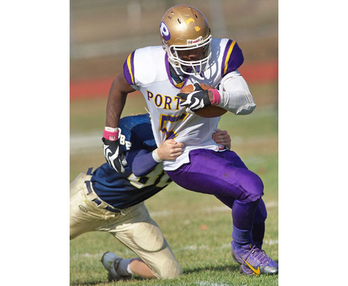 Gene Allen, shown in a game against Bayport-Blue Point last season, proved to be tough to tackle. The Greenport/Southold/Mattituck senior has made Hartwick College his college choice. (Credit: Garret Meade file)