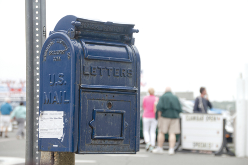 This small, antique — and still working — mailbox on Main Street in Greenport is slated to be removed and replaced with a more modern collection box up the road. Some who live in or work in the area aren't happy about that. (Credit: Paul Squire)