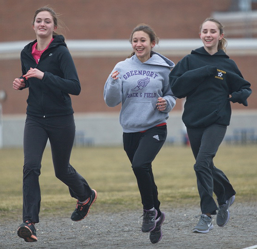 GARRET MEADE PHOTO | From left, Greenport's Megan Murray, Marina DeLuca and Emma Marshall hit the track during practice.