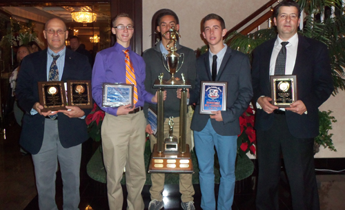 COURTESY PHOTO | From left, junior varsity coach Tom Taylor, Ryan Weingart, Byron Rivas, Eddie Rogers and coach Chris Golden show off awards they won, including the Suffolk County Soccer Officials Sportsmanship Award.