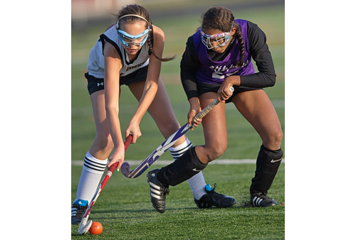 GARRET MEADE PHOTO | Southampton's Ana O'Shaugnessy, left, and Greenport/Southold's Adrianna Chandler pursuing the ball during Monday's playoff game.