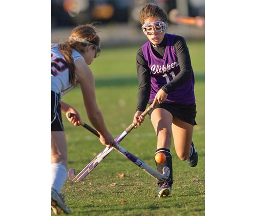 GARRET MEADE PHOTO | Babylon's Hannah Walsh, left, and Greenport/Southold's Toni Esposito crossing sticks as they cross paths during Thursday's final regular-season game for both teams.
