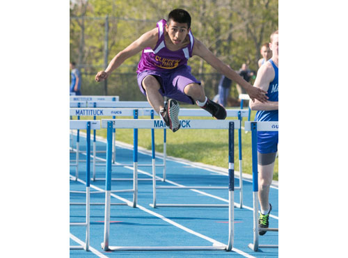 Greenport/Southold's Oscar Coc-Tomas came in first place in the 110-meter high hurdles in 20.1 seconds, a personal record. (Credit: Katharine Schroeder)