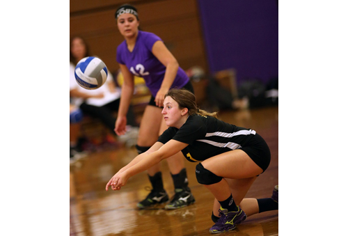 Greenport/Southold's libero, Sam Henry, attempts a dig while teammate Jenna Standish watches. (Credit: Garret Meade)
