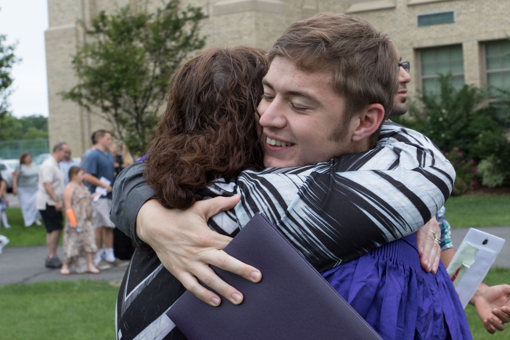 A hug for the new graduate.