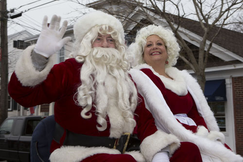 KATHARINE SCHROEDER PHOTO | Santa and Mrs. Claus arrive in Greenport Sunday.
