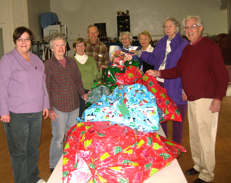 Members of Holy Trinity Episcopal Church in Greenport partnered with the Greenport School District and Community Action Southold Town in adopting three local families during the holidays and into next year. They bought, wrapped and delivered coats, gloves, hats and winter clothing as well as gift cards for toys and food.