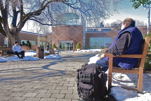 Former taxi driver Charlie, homeless since September, sits outside the Riverhead Free Library one recent afternoon. (Credit: Barbaraellen Koch, file)