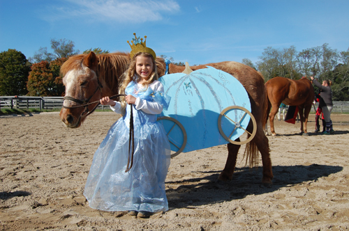 Elle O'Neill, 7, of Peconic  won first place in a Halloween costume contest at Hedwig Farms in Laurel for her Cinderella-themed costumes.