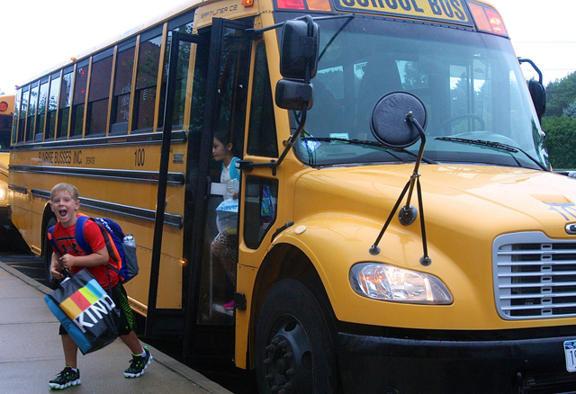 Third grader Matt McGunnigle showed his excitement as he stepped off the bus. He said he couldn't wait to see his friends and learn.