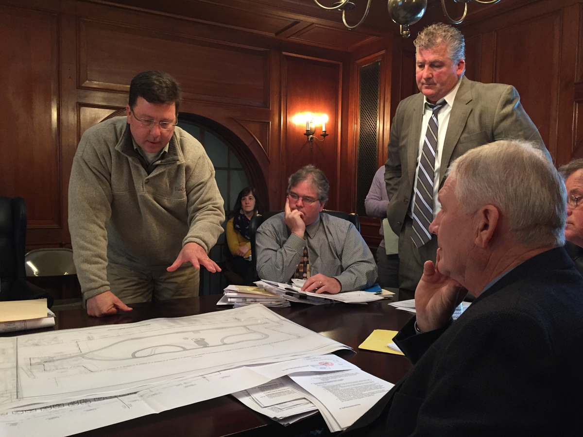 Heritage at Cutchogue architect Charles Kuehn (left) goes over the development's proposal with planning board members at Monday's work session meeting. (Credit: Paul Squire)