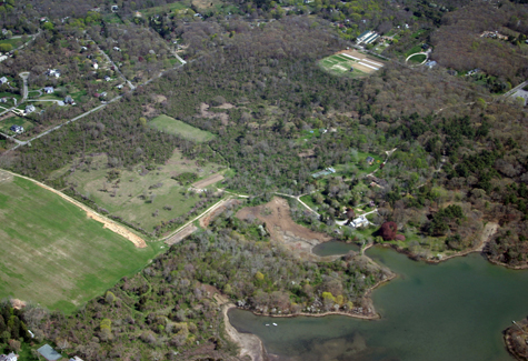 The woods, fields, buildings and 18th century manor house (close to Gardiners Creek shoreline at lower right) at Sylvester Manor on Shelter Island.