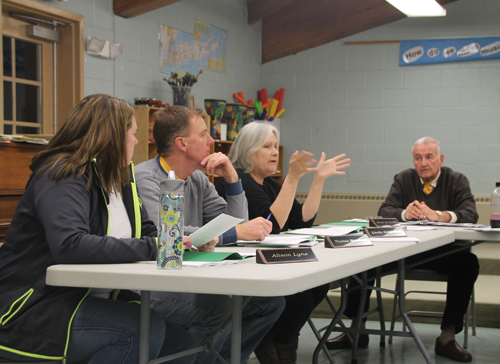 PAUL SQUIRE PHOTO | Board member Linda Goldsmith (second from right) discusses the veterans tax exemption with the rest of the board at Tuesday night's public hearing.