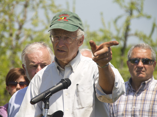 Cutchogue farmer Tom Wickham points to preserved land near his farm at a press conference Monday afternoon. Mr. Wickham said federal funds would allow farmers to upgrade to better practices cheaper. (Credit: Paul Squire)