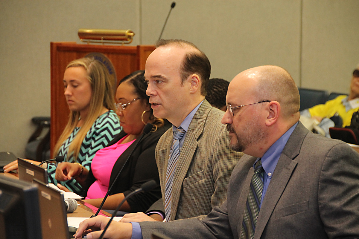 Neal Lewis (second from right) presents a proposed county Climate Action Plan at Tuesday's meeting. (Credit: Paul Squire)