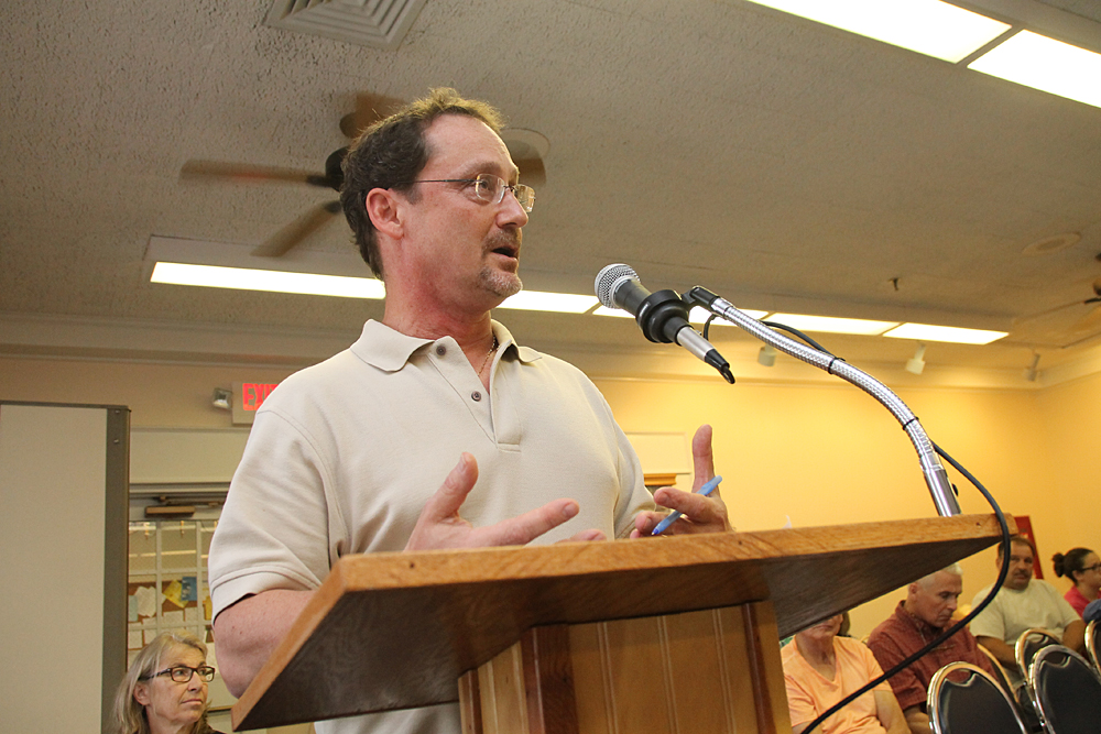 Robert DeLuca, CEO of Group for the East End, speaks at a public hearing Monday night. (Credit: Paul Squire)