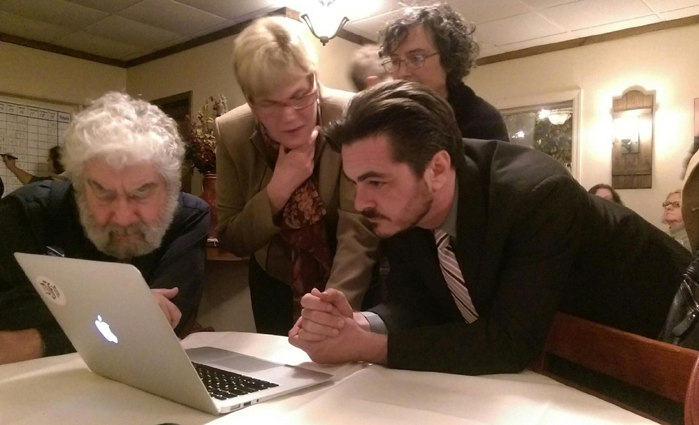 Town supervisor candidate Damon Rallis looks at the results Tuesday night. (Credit: Chris Lisinski)