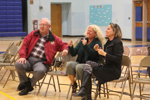 JENNIFER GUSTAVSON PHOTO | From left, Mattituck-Cutchogue school board member Jeff Smith, parents Jeanine Warns and Terri Boyle Romanelli the moment the track bond vote results were announced Tuesday night.