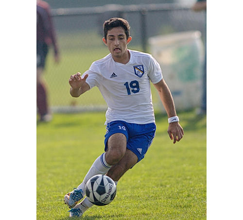 Mattituck's Kaan Ilgin, pictured in the team's game against Southampton, scored two goals in Tuesday's win over Wheatley in the Class B Long Island title game. (Credit: Garret Meade)