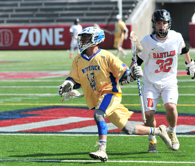 Mattituck senior Jack DiGregorio carries the ball against Babylon in Wednesday's county championship. (Credit: Bill Landon)