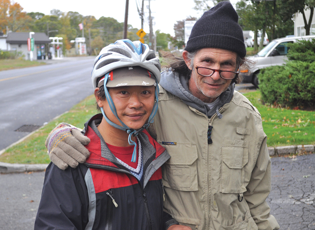 Jason Tang, left, with David Markel of Southold the morning after they met during a nor'easter last week. (Credit: Joe Werkmeister)