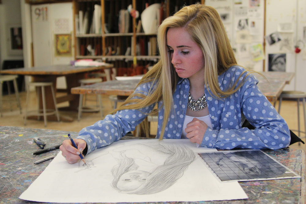 Southold High School senior Juliane Van Gorden sketches a self-portrait after school earlier this month. She travels into Manhattan once a week to take classes at Fashion Institute of Technology. (Credit: Jen Nuzzo photos)