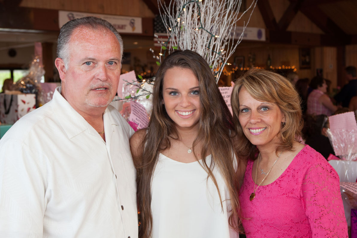 Kait's family: her father Joseph, sister Carly and mother Daria. (Credit: Katharine Schroeder)