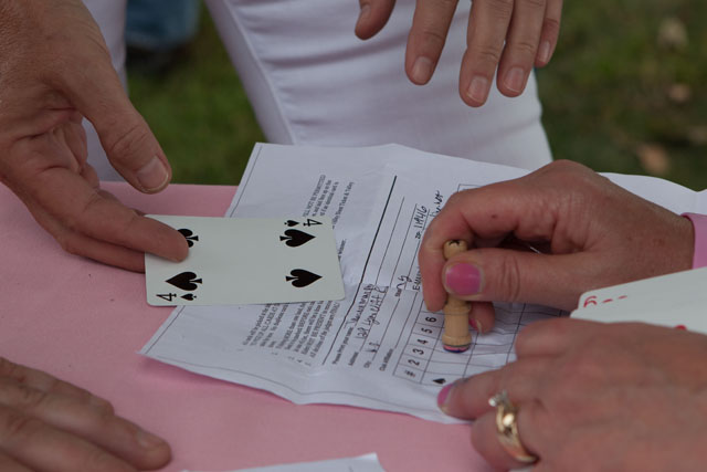 A participant gets his last card stamped on his game sheet. (Credit: Katharine Schroeder)
