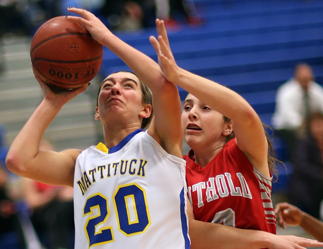 Mattituck's Katie Hoeg, pictured against Southold Monday, scored eight points in the league opening win against Southampton Thursday night. (Credit:  Garret Meade)