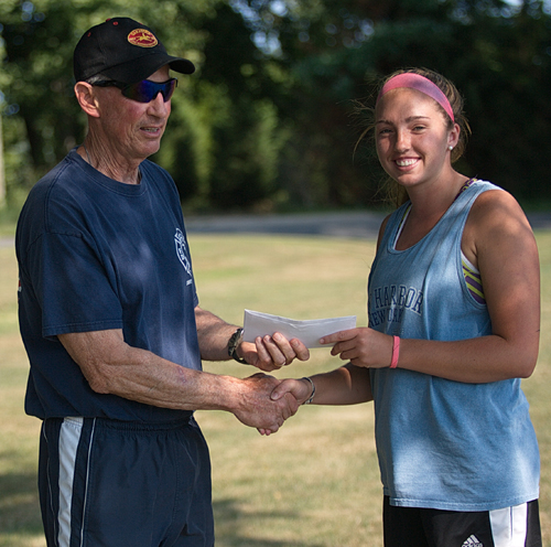 Tournament director Jim Christy presenting a scholarship to Molly Kowalski before the women's singles final on Friday. Declining player participation has brought an end to the 36-year tournament. (Credit: Garret Meade)