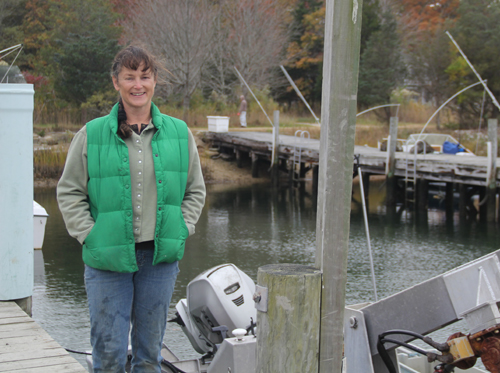 CARRIE MILLER PHOTO | Karen Rivara on the dock at her Southold based oyster business.