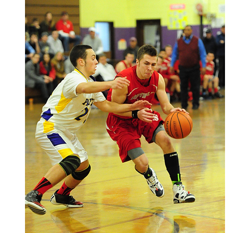 ROBERT O'ROURK PHOTO  |  Southold's Liam Walker drives toward the basket against Greenport's Gavin Dibble.