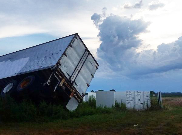 A tractor trailer that overturned due to the wind on the Lewin Farms property in Wading River. (Credit Lewin Farms, courtesy)