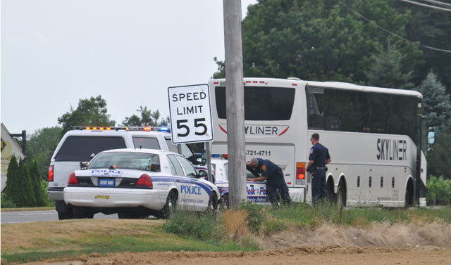 A bus is inspected along Route 48 in Cutchogue by officers from the Suffolk County and Southold Town police departments. (Credit: Grant Parpan)