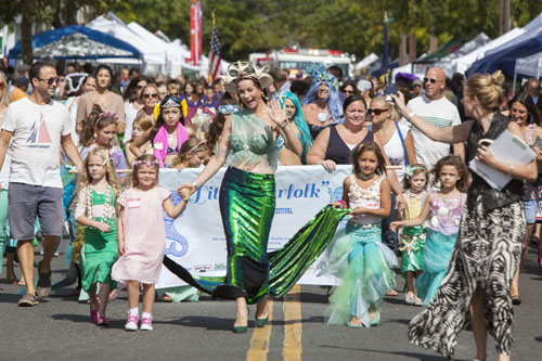 Contestants in the Little Merfolk Contest participate in the parade at the Greenport Maritime Festival Saturday.