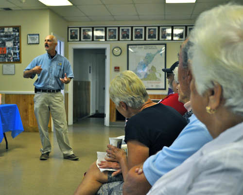 "RACHEL YOUNG PHOTO | Southold Town emergency coordinator Lloyd Reisenberg addresses East Marion residents at Saturday's ""Southold Town Responds to Sandy"" event at the East Marion Fire House."