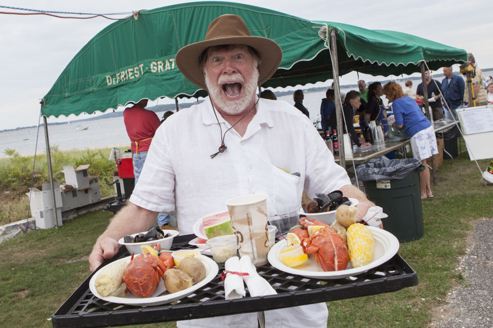 Greg Swords, who is visiting from Georgia, having a good time at Saturday's lobsterfest in Southold. (Credit: Katharine Schroeder photos)