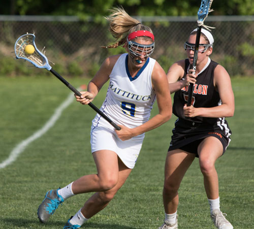 Mattituck/Greenport/Southold's Katie Hoeg, guarded by Babylon's Megan Nerney, had three goals and two assists in the Tuckers' first ever playoff win. (Credit: Katharine Schroeder)