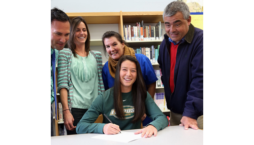 Trish Brisotti signed on to accept an athletic scholarship from C.W. Post. Joining her in the signing ceremony were, from left, Mattituck athletic director Gregg Wormuth, her former coach Julie Milliman, and her parents Kerry and David. (Credit: Garret Meade)