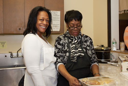 Geraldine Carter, right, with her daughter, Angie Smith, in the kitchen.