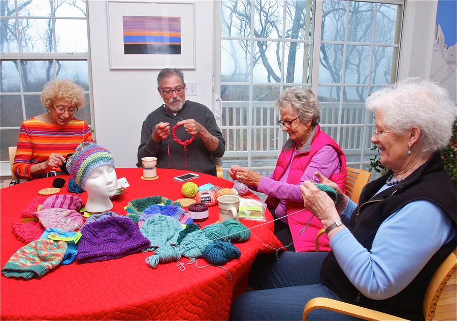 The Mad Hatters (from left) Sue Hanauer of Riverhead, Harold Gordon of Mattituck, Rita Cohen of Southold and Prue Brashich of Cutchogue during last week's bi-monthly knitting session at Ms. Hanover's kitchen table. (Credit: Barbaraellen Koch)