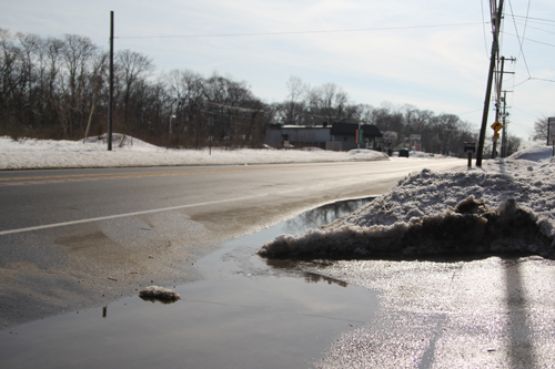 Today's sunshine and warmer temps melted some snow here on Main Road. (Credit: Jen Nuzzo)