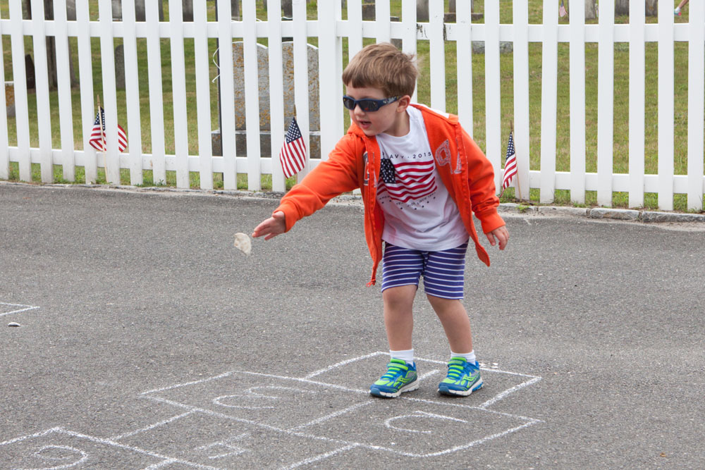 Tony Raynor, 3, of Mattituck enjoying a game of hopscotch.